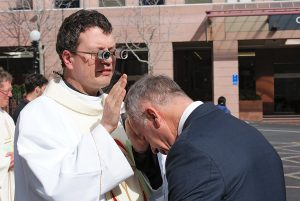 Fr Justin Glyn, SJ, gives his blessing to Anthony Segedin after the ordination Mass.